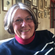 Photo of woman smiling with glasses.