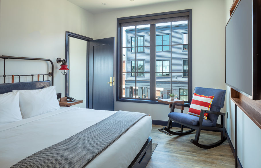 Harbor suite bedroom with rocking chair.