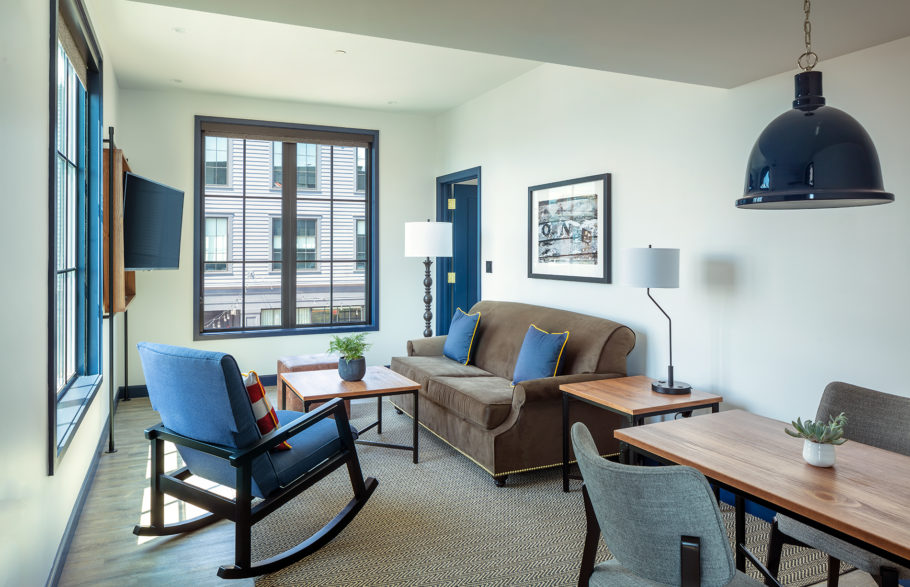 Harbor suite parlor - couch, chair, and dining table.