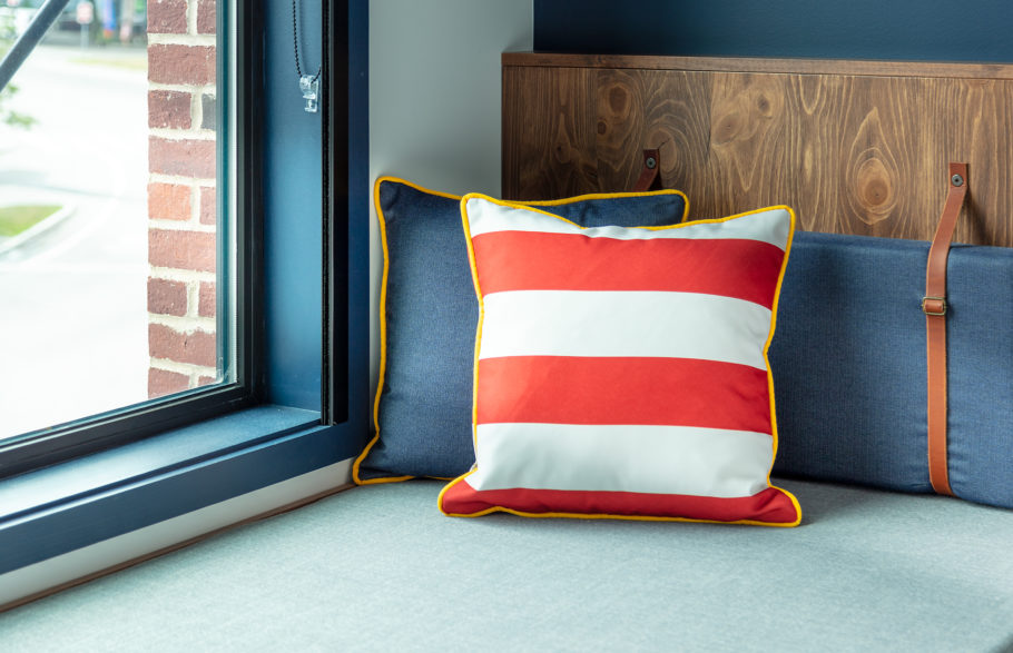 Navy pillow and red and white striped pillow.